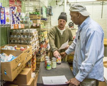 Patrons get monthly food staples from our Food Pantry